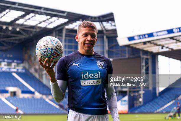 Dwight Gayle of West Bromwich Albion with the signed match ball at full time after his hat trick during the Sky Bet Championship match between West...