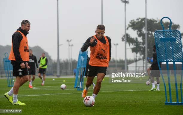 Dwight Gayle passes the ball during the Newcastle United Training session at Queen Ethelberga's Collegiate on August 19 2020 in York England