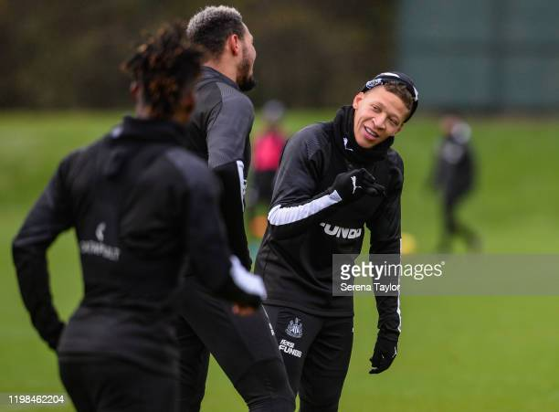 Dwight Gayle smiles at Joelinton during the Newcastle United Training Session at the Newcastle United Training Centre on January 09 2020 in Newcastle...