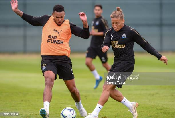 Dwight Gayle strikes the ball which is deflected by Jamaal Lascelles during the Newcastle United Training session at Carton House on July 15 in...