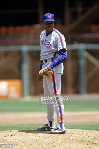 Dwight Gooden of the New York Mets lines up a pitch during a game in the 1990 season