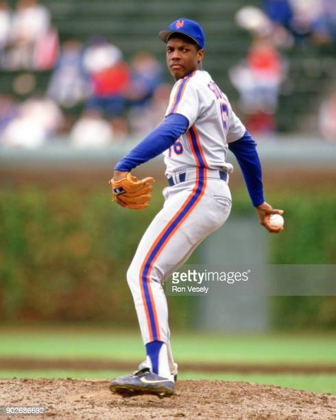Dwight Gooden of the New York Mets pitches during an MLB game versus the Chicago Cubs at Wrigley Field in Chicago Illinois during the 1986 season