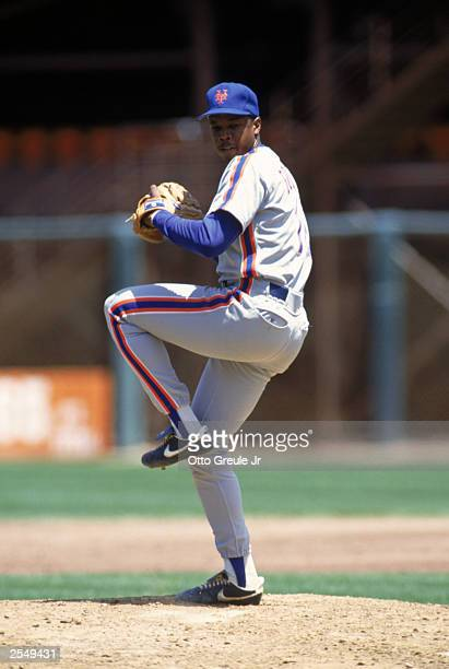 Dwight Gooden of the New York Mets winds back to pitch during a game in the 1990 season