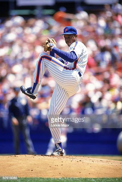 Dwight Gooden of the New York Mets winds up for a pitch during a game in 1990 at Shea Stadium in Flushing New York