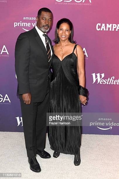 Dwight Hicks and guest attend The 21st CDGA at The Beverly Hilton Hotel on February 19 2019 in Beverly Hills California