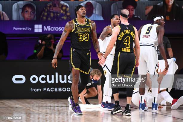 Dwight Howard and Alex Caruso of the Los Angeles Lakers hifive during the game against the Denver Nuggets during Game Two of the Western Conference...