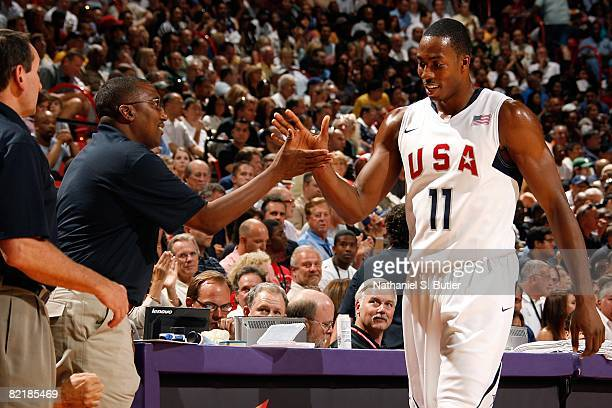 Dwight Howard and athletic trainer Keith Jones of the United States Men's Senior National Basketball Team celebrate during the game against the...