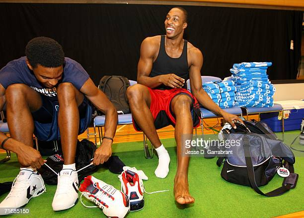 Dwight Howard and Chris Bosh of the USA Basketball Senior Men's National Team change during practice at the Hokkaido Perfectual Sports Center August...