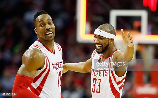 Dwight Howard and Corey Brewer of the Houston Rockets celebrate a threepoint basket during their game against the Miami Heat at the Toyota Center on...