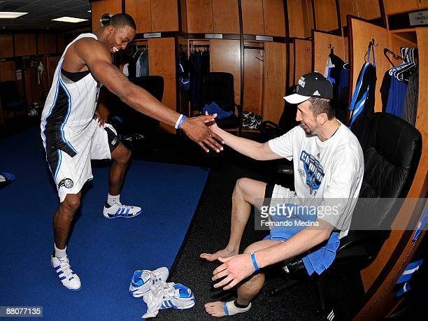 Dwight Howard and Hedo Turkoglu of the Orlando Magic celebrate after defeating the Cleveland Cavaliers 103-90 in Game Six of the Eastern Conference...