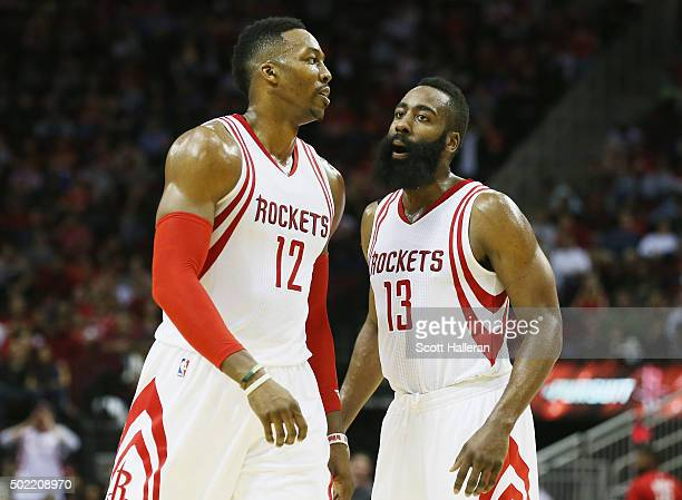 Dwight Howard and James Harden of the Houston Rockets walk across the court during their game against the Charlotte Hornets at Toyota Center on...