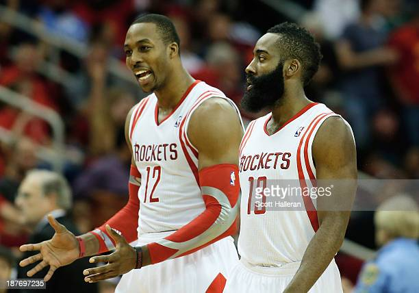 Dwight Howard and James Harden of the Houston Rockets walk off the court during the game against the Toronto Raptors at Toyota Center on November 11...