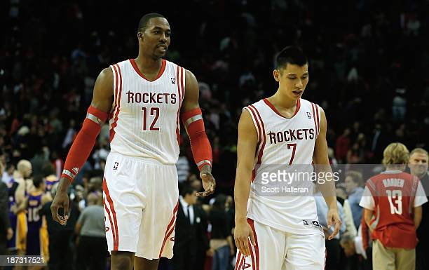 Dwight Howard and Jeremy Lin of the Houston Rockets walk off the court after losing to the Los Angeles Lakers 9998 during the game at Toyota Center...