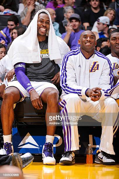 Dwight Howard and Kobe Bryant of the Los Angeles Lakers smile on the bench as their teammates play the Detroit Pistons at Staples Center on November...
