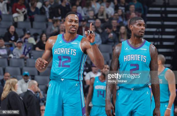 Dwight Howard and Marvin Williams of the Charlotte Hornets look on during the game against the Sacramento Kings on January 2 2018 at Golden 1 Center...