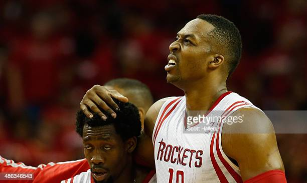 Dwight Howard and Patrick Beverley of the Houston Rockets walk to the bench against the Portland Trail Blazers during the second half of Game Two of...