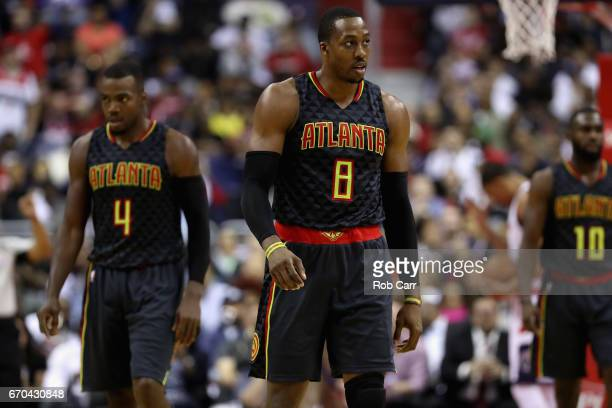 Dwight Howard and Paul Millsap of the Atlanta Hawks walk off the floor during the timeout in the first half against the Washington Wizards in Game...