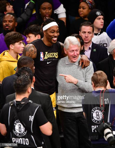 Dwight Howard and President Bill Clinton pose together after Los Angeles Lakers v Brooklyn Nets game at Barclays Center on January 23 2020 in New...