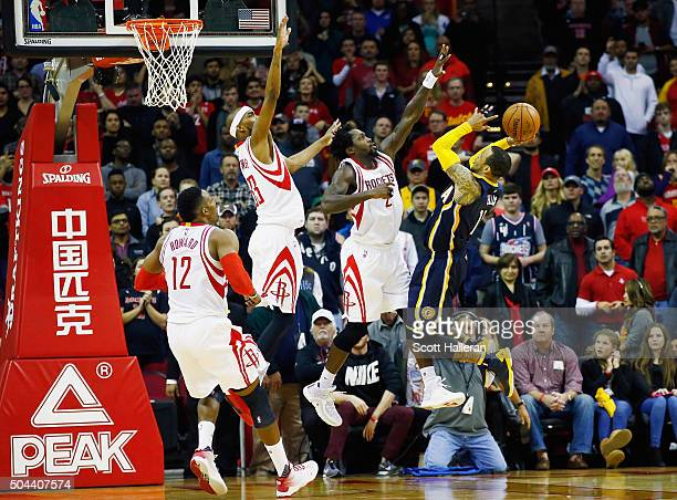 Dwight Howard Corey Brewer and Patrick Beverley of the Houston Rockets defend against Monta Ellis of the Indiana Pacers during their game at the...