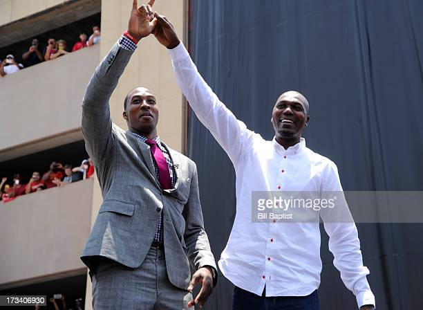 Dwight Howard is introduced as the newest Rocket by Rockets center legend Hakeem Olajuwon to the Rockets on July 13 2013 at The Toyota Center Houston...