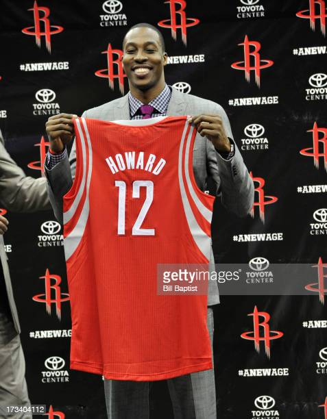 Dwight Howard is introduced as the newest Rocket He holds up his new jersey for members of the media on July 13 2013 at The Toyota Center Houston...