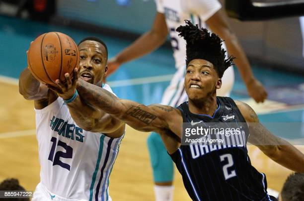 Dwight Howard of Charlotte Hornets and Elfrid Payton of Orlando Magic reaches for the ball during an NBA match between Orlando Magic and Charlotte...