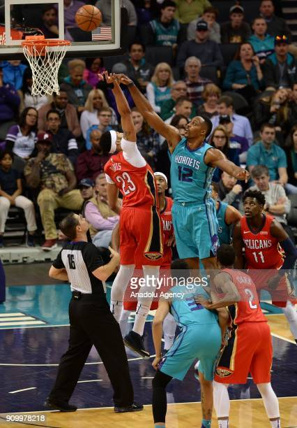 Dwight Howard of Charlotte Hornets in action against Anthony Davis of New Orleans Pelicans during NBA match between Charlotte Hornets and New Orleans...