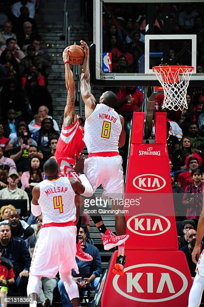 Dwight Howard of the Atlanta Hawks blocks a shot by KJ McDaniels of the Houston Rockets during a game on November 5 2016 at Philips Arena in Atlanta...