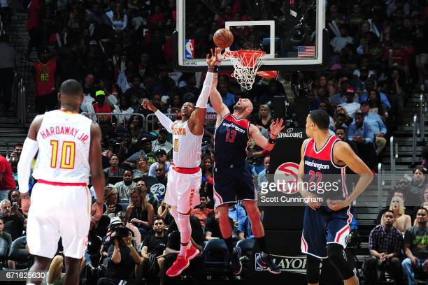 Dwight Howard of the Atlanta Hawks goes for the rebound against Marcin Gortat of the Washington Wizards in Game Three of the Eastern Conference...