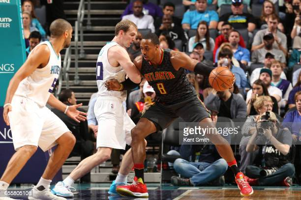 Dwight Howard of the Atlanta Hawks handles the ball during a game against the Charlotte Hornets on March 20 2017 at Spectrum Center in Charlotte...