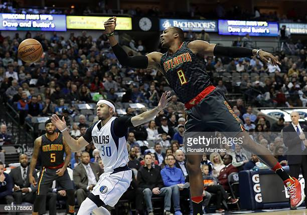 Dwight Howard of the Atlanta Hawks reaches for a loose ball against Seth Curry of the Dallas Mavericks at American Airlines Center on January 7 2017...