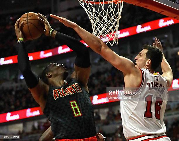 Dwight Howard of the Atlanta Hawks shoots against Paul Zipser of the Chicago Bulls at the United Center on January 25 2017 in Chicago Illinois The...