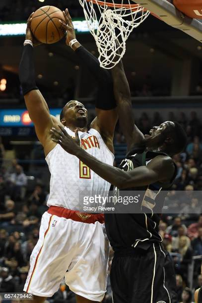 Dwight Howard of the Atlanta Hawks shoots over Thon Maker of the Milwaukee Bucks during the first half of a game at the BMO Harris Bradley Center on...