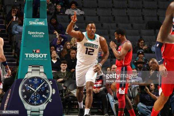 Dwight Howard of the Charlotte Hornets celebrates a score during the game against the Washington Wizards on January 17 2018 at Spectrum Center in...