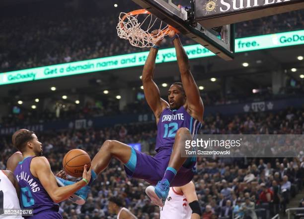 Dwight Howard of the Charlotte Hornets dunks the ball against the Toronto Raptors during NBA game action at Air Canada Centre on November 29 2017 in...