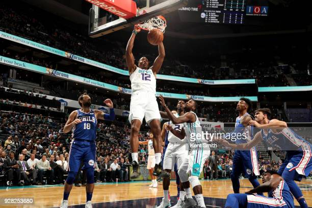 Dwight Howard of the Charlotte Hornets dunks the ball during the game against the Philadelphia 76ers on March 6 2018 at Spectrum Center in Charlotte...