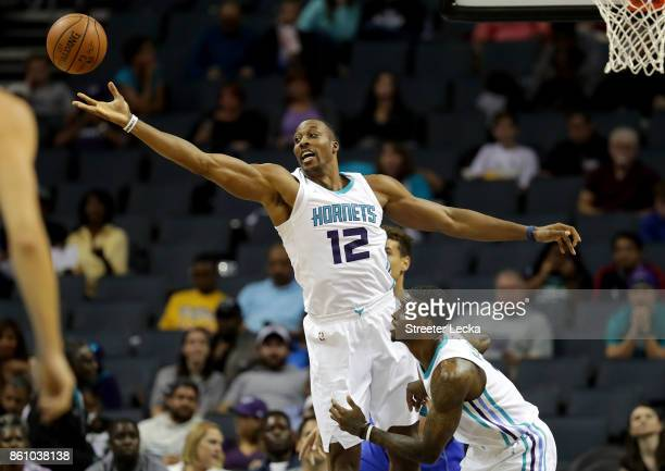 Dwight Howard of the Charlotte Hornets goes after a loose ball against the Dallas Mavericks during their game at Spectrum Center on October 13 2017...