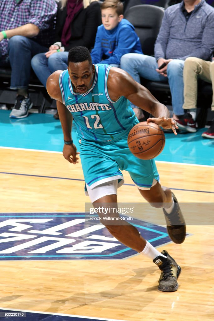 Dwight Howard #12 of the Charlotte Hornets handles the ball against the Phoenix Suns on March 10, 2018 at Spectrum Center in Charlotte, North Carolina.