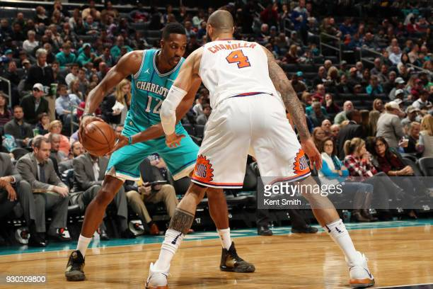 Dwight Howard of the Charlotte Hornets jocks for a position during the game against the Phoenix Suns on March 10 2018 at Spectrum Center in Charlotte...