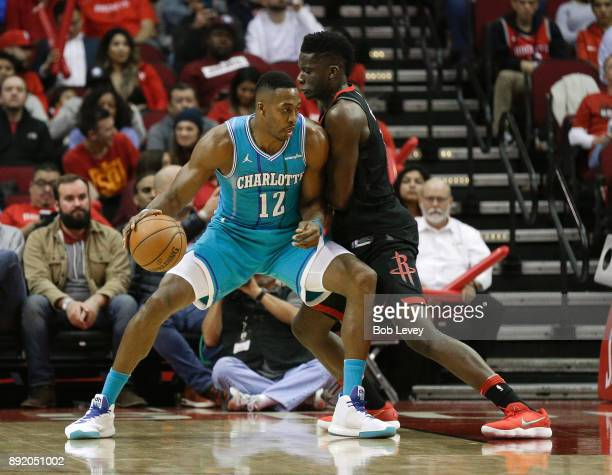 Dwight Howard of the Charlotte Hornets posts up on Clint Capela of the Houston Rockets at Toyota Center on December 13 2017 in Houston Texas NOTE TO...