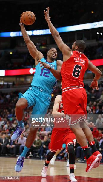 Dwight Howard of the Charlotte Hornets puts up a shot against Cristiano Felicio of the Chicago Bulls at the United Center on April 3 2018 in Chicago...