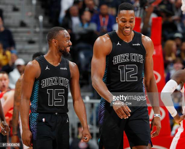 Dwight Howard of the Charlotte Hornets reacts with Kemba Walker after drawing a foul on his dunk over Mike Muscala of the Atlanta Hawks at Philips...