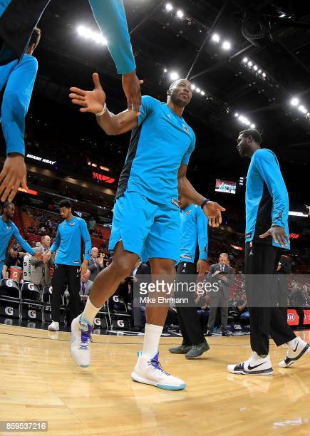 Dwight Howard of the Charlotte Hornets takes the floor during a preseason game against the Miami Heat at American Airlines Arena on October 9 2017 in...