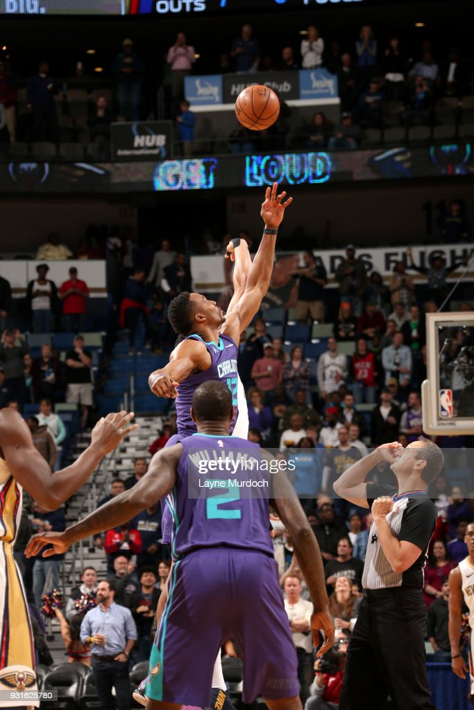 Dwight Howard #12 of the Charlotte Hornets tips off against the New Orleans Pelicans at the start of the game on March 13, 2018 at Smoothie King Center in New Orleans, Louisiana.