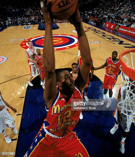 Dwight Howard of the East Boys team takes the ball to the basket during the McDonalds All American High School Game at Ford Center on March 31 2004...