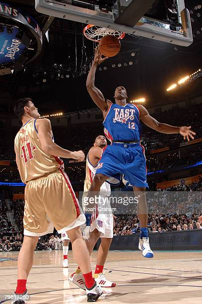 Dwight Howard of the Eastern Conference dunks the ball by Yao Ming of the Western Conference during the 2008 NBA AllStar Game part of 2008 NBA...