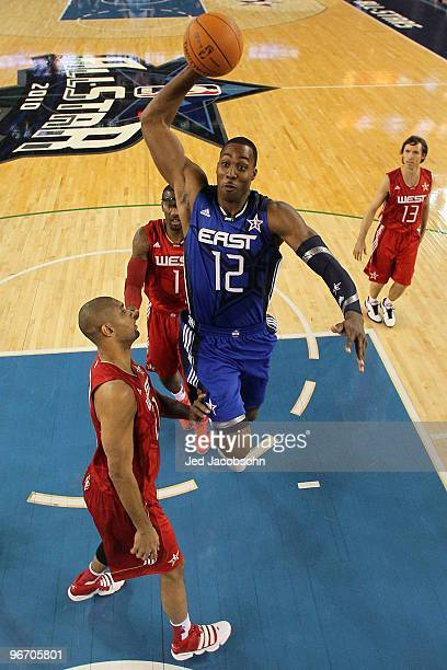Dwight Howard of the Eastern Conference goes up for a dunk against Tim Duncan Amar'e Stoudemire and Steve Nash of the Western Conference during the...
