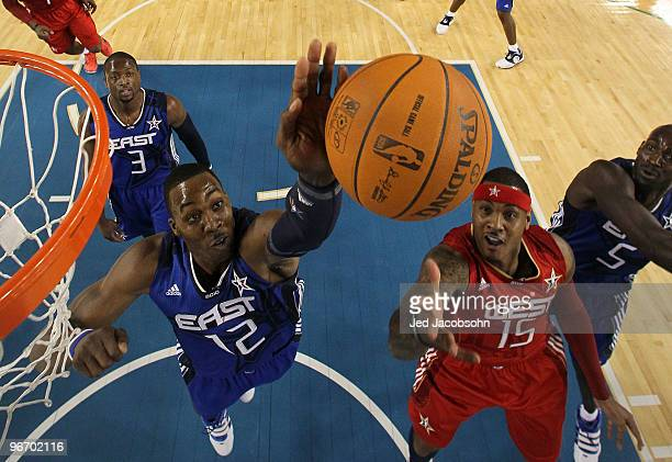 Dwight Howard of the Eastern Conference rebounds against Carmelo Anthony of the Western Conference during the first half of the NBA AllStar Game part...
