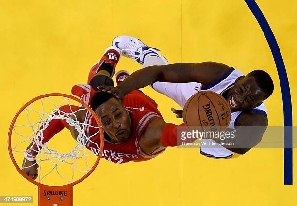 Dwight Howard of the Houston Rockets and Draymond Green of the Golden State Warriors go after the ball during game five of the Western Conference...