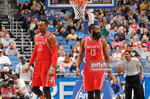 Dwight Howard of the Houston Rockets and James Harden of the Houston Rockets stand on the court against the Orlando Magic on December 23 2015 at...